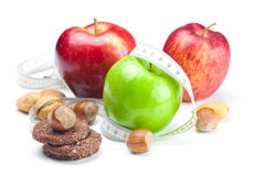 Apple, nuts, cookies and measure  tape Royalty Free Stock Images
