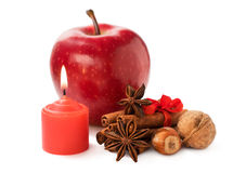 Apple with nuts, star anise , cinnamon and a candle Stock Photography