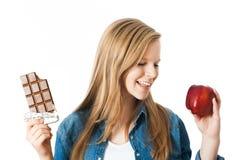 Apple o chocolate Fotos de archivo