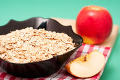 Apple  with oat flakes in bowl Stock Photos