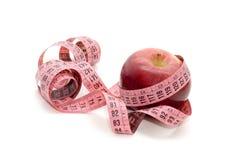 Apple och att mäta tejpar arkivfoton