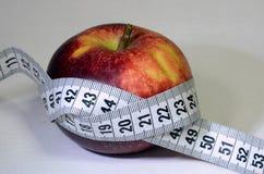 Apple och centimetemusikband royaltyfri fotografi