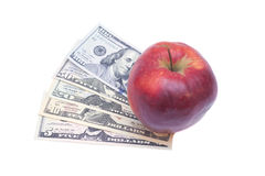 Apple och dollar som isoleras på en vit Arkivfoton
