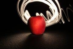 Apple och ljus 1 arkivbild