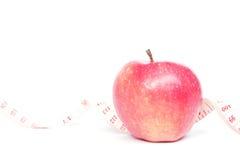 Apple och mätande band Royaltyfri Fotografi