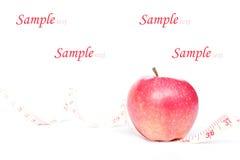 Apple och mätande band Arkivfoto
