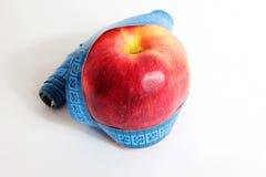 Apple och måttband Arkivbilder