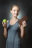 Apple oder Schokolade Lizenzfreie Stockbilder