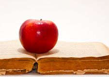 Apple on the old book Stock Photos