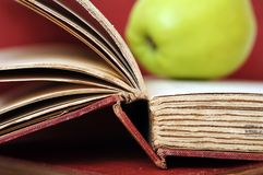 Apple and old book Royalty Free Stock Images