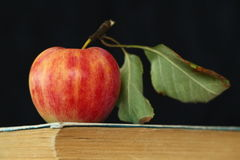 Apple and old book Stock Photo