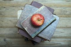 Apple and old books Stock Image