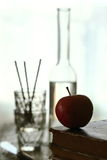 Apple and old books Royalty Free Stock Photos
