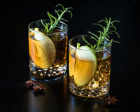 Apple Old Fashioned with Rosemary stock photos
