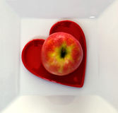 Apple On Heart Plate Stock Photography