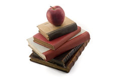 Apple On Old Books Stock Photos