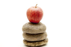 Apple onto stacked stones Royalty Free Stock Photography