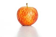 Apple op witte achtergrond wordt geïsoleerd die stock foto's