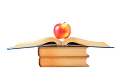 Apple and an open book. Isolated on white stock images