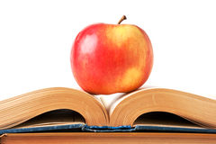 Apple and an open book. Isolated on white Royalty Free Stock Photo