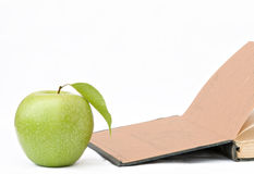 Apple and open book. Isolated on white background Royalty Free Stock Images