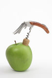 Apple Opening With Corkscrew Royalty Free Stock Photography
