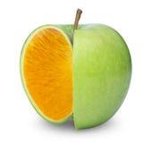 Apple Orange. Orange inside a green apple Royalty Free Stock Photo