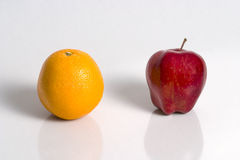 Apple and Orange. An apple and an orange Royalty Free Stock Photography