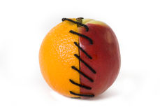 Apple and orange. Half of apple and orange tied together Royalty Free Stock Photo