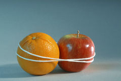 Apple and Orange. Bound together Royalty Free Stock Image
