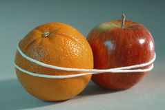 Apple and Orange. Bound together Royalty Free Stock Photos