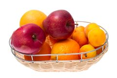 Apple, orange, apricot on bowl isolated on white Royalty Free Stock Images