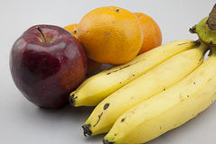 Apple, Orange, And Banana. Are sitting next to each other Royalty Free Stock Photography