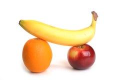 Apple,Orange and Bannana. Shot in studio on a white background Stock Photos