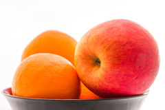 Apple with orange. Apple with orange in the bowl royalty free stock photography