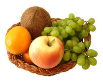 Apple, orange, coconut and grapes in basket on white background Stock Photo