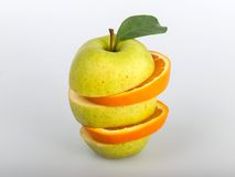 Apple and orange. The combination of pieces of apples and oranges Stock Photography
