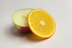 Apple&orange. A cross section of orange and apple stock image