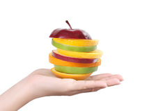 Apple and orange in hand Stock Photos