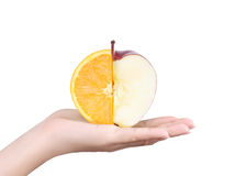 Apple and orange in hand Royalty Free Stock Photo