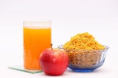 Apple, orange juice and snacks royalty free stock photography