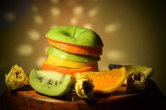 Apple orange kiwi lemon rose stock image
