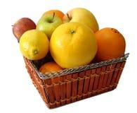 Apple, orange, lemon in basket Royalty Free Stock Images