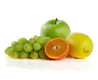 Apple, orange, lemon, grape, on a white background Stock Photography