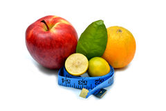 Apple orange and lemons with measure tape isolated Stock Photo