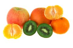 Apple, orange, mandarin and kiwi fruit. On a white background Royalty Free Stock Photo