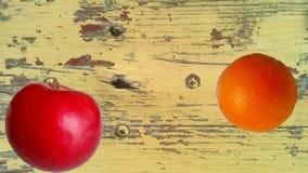 Apple and orange on old fashion background Royalty Free Stock Photography