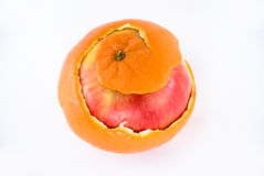 Apple in orange peel stock photo