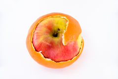 Apple in orange peel Royalty Free Stock Photography