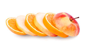 Apple and orange slices. On white background royalty free stock photo